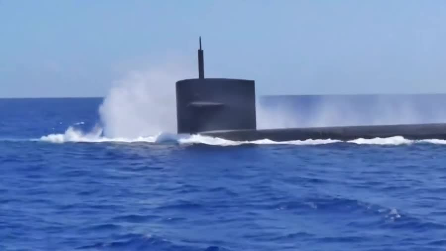 A Navy Comp. Shock and Awe Yes, that's a submarine firing a cruise missile from underwater The Phalanx CIWS being loaded and fired US Sub diving next to dolphin
