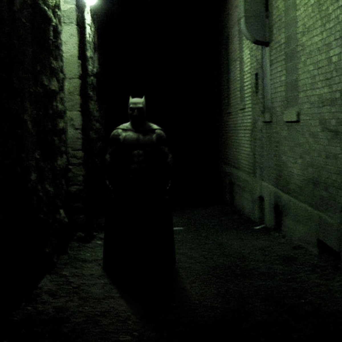 Alley Bat. What Batman looks like to a superstitious, cowardly lot... shouldn't have bought that chocolate ice-cream