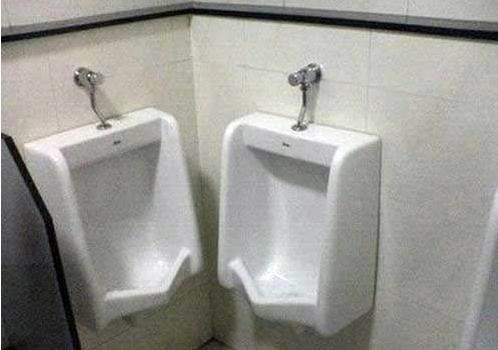 Awkward Urinals. Ummm...I hope the guys don't really pee like this.... When you gotta go, you gotta go............
