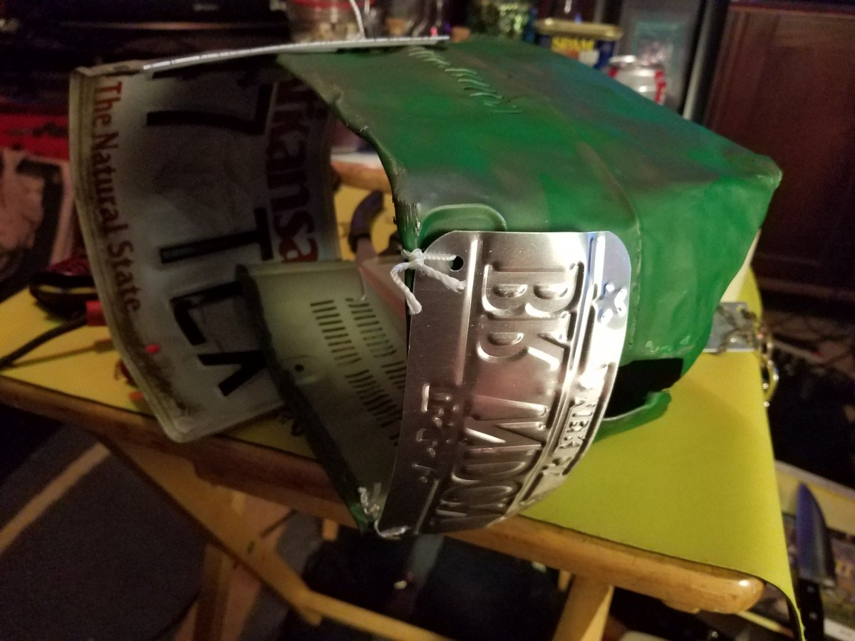 """Im making a helmet!. Im gonna be a budget knight. I ran out of scrap metal though. I need more. And maybe a drill and bolts instead of string... ......................... This looks just like the """"coffee can"""" helmet from rust"""