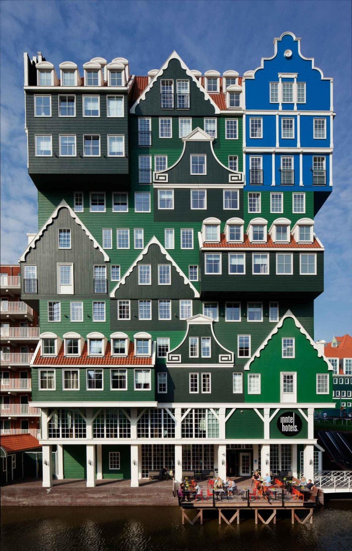 "Inntel Hotels (Zaandam, The Netherlands). .. ""where do you live"" ""in the weird ass building made of green and blue houses"""