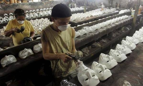 Irony. The image above shows the anti-capitalism Guy Fawkes mask being produced in a sweat shop... V for Vendetta didn't have an anti-capitalist message. It was anti-fascism and totalitarianism.