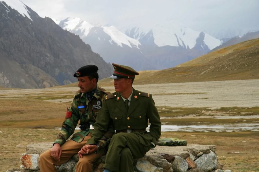 lewd handholding. Two border guards I believe, on the Chinese-Pakistan border... are they gay or just making some political statement