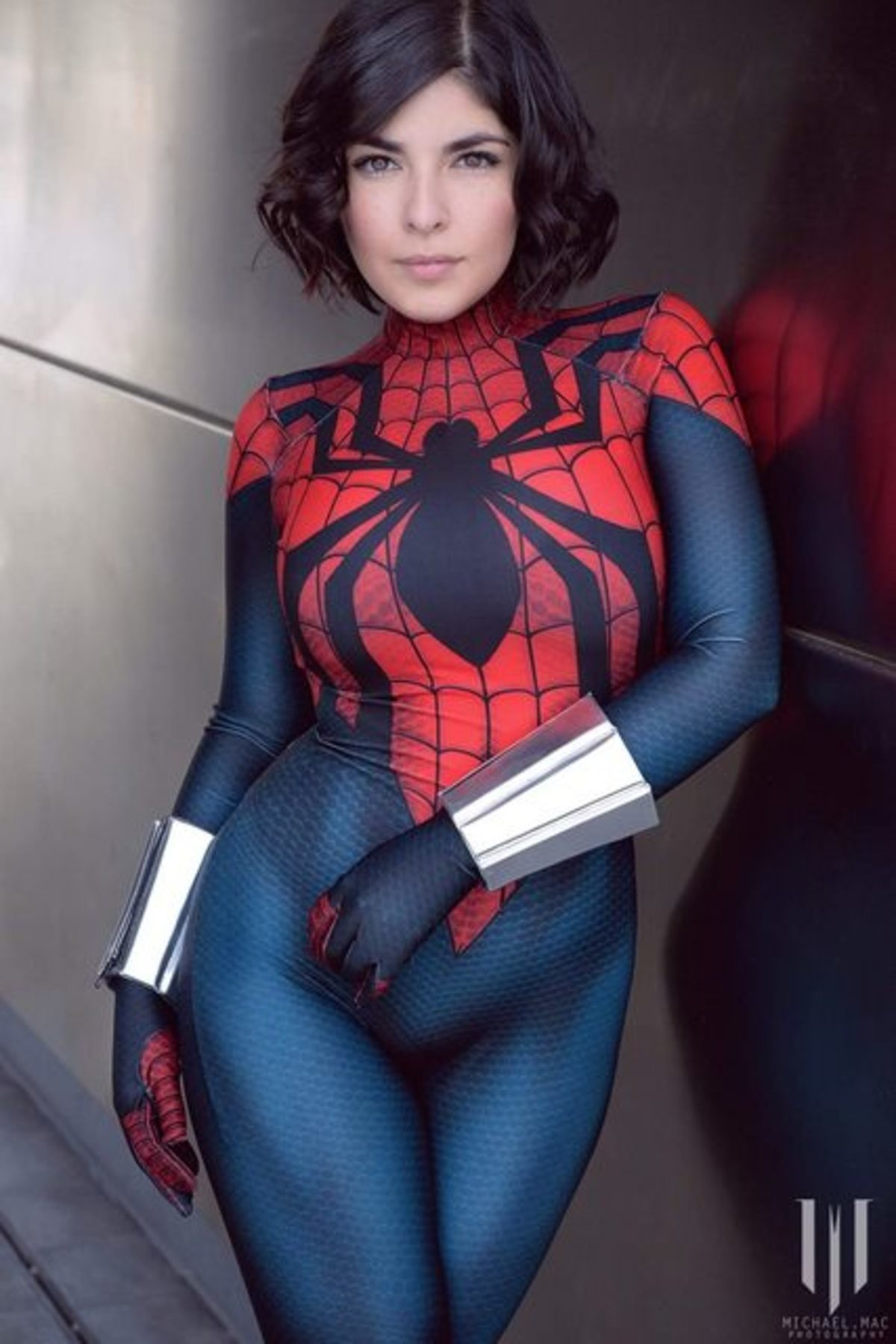 Spider-Woman. .. I'd shoot my web with her.
