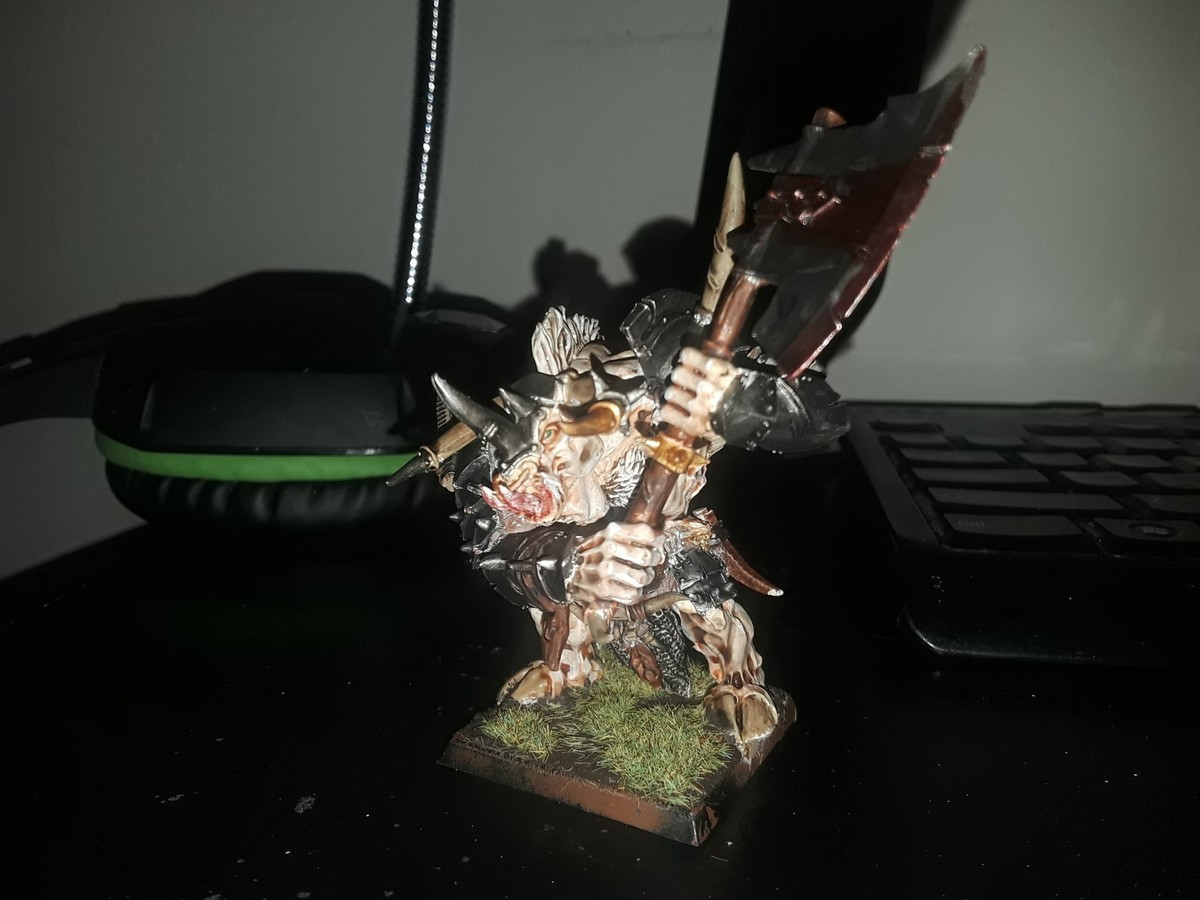 Tarruin Bloodhorn: Slaaneshi Doombull. I tried painting him albino with green eyes, and while it won't win any Golden Demons, I'm proud of it..