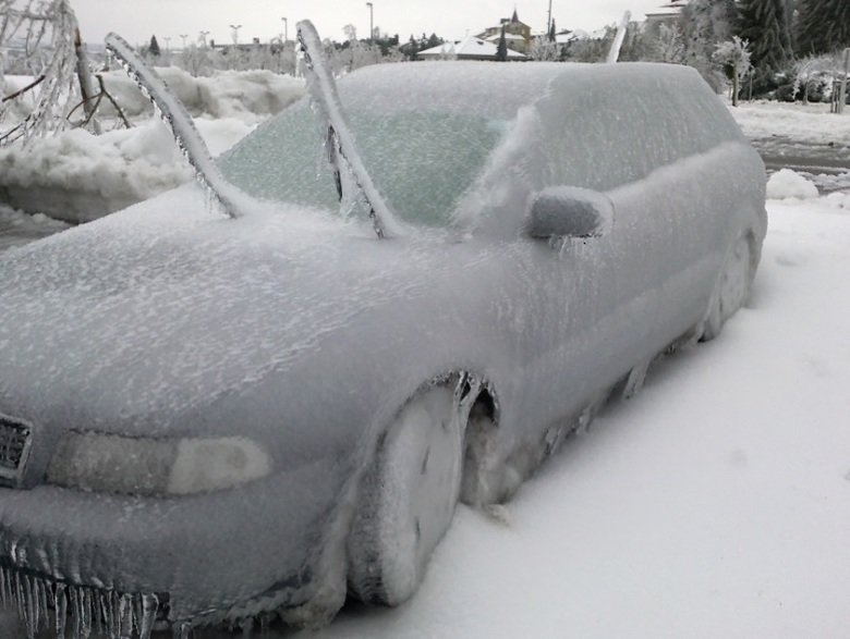 wipers vs freezing rain. .. How to deal with cold whether--- Step one- Boil a large pot of water Step two- Pour hot water on windows and then the rest of the car Step three- If ice is stil